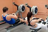 Concentrated people using a rower