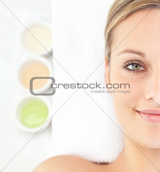 Portrait of an attractive young woman lying on a massage table