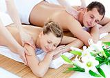 Charming young couple enjoying a back massage