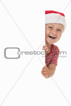 smiling child with xmas hat