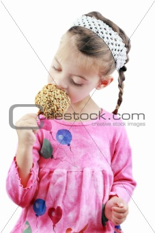 Child Eating a Caramel Apple