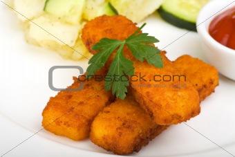 three fish fingers and potatoe salad