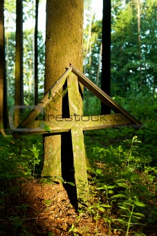 old wooden cross in a forest