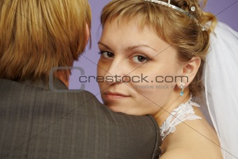 Portrait of bride near to groom