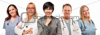 Young Multiethnic Woman with Doctors and Nurses Behind Isolated on a White Background.