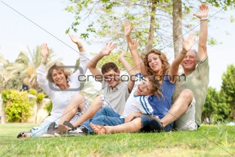 potrait of family waving hands