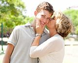 Image of Portrait of a happy senior woman kissing grandson