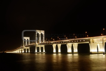 Bright bridge in dark night