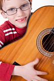 Cute boy with a guitar,