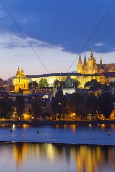czech republic, prague - hradcany castle and st. nicolaus church at dusk