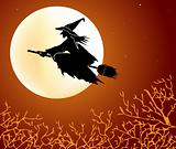 Witch flying on a broom against the moon
