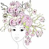 Young woman face with pink flowers