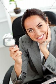 Beautiful businesswoman holding a light bulb