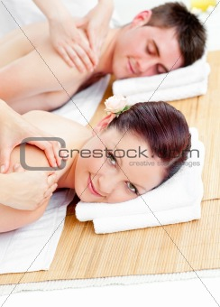 Delighted caucasian couple receiving a back massage