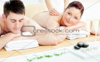 Attractive caucasian couple receiving a back massage