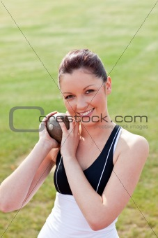 Attractive female athlete holding weight