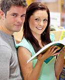 Caucasian couple looking for a book