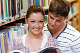 Young caucasian couple reading a book