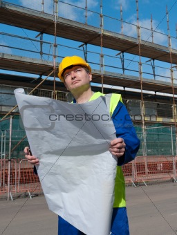 Foreman on buiding site looks up