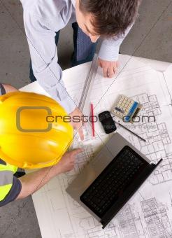 Architect and builder discuss blueprint