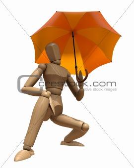 Posing wooden manikin with umbrella.