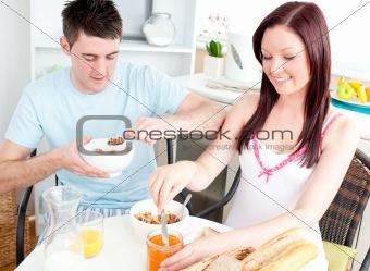 Caucasian couple having breakfast in the kitchen