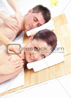 Attractive young couple receiving a back massage