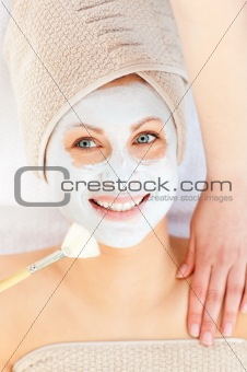 Bright young woman enjoying a beauty treatment