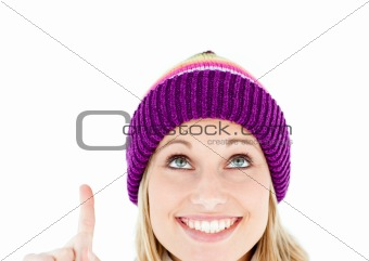 Joyful woman pointing upward