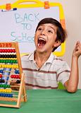 Boy with abacus screaming loudly