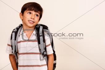 Portrait of young schoolboy looking away