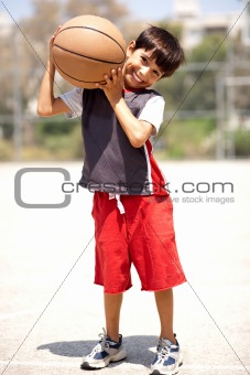 Boy with basketball on his shoulders