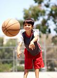 Young boy passing basketball