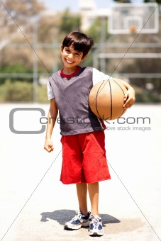 Adorable boy with basketball