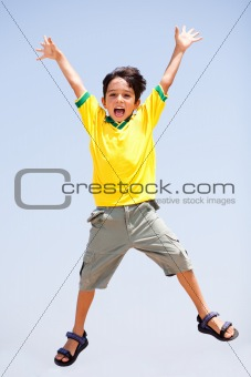 Smart kid jumping high in air