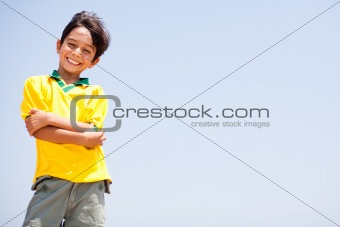 Charming kid posing with folded arms