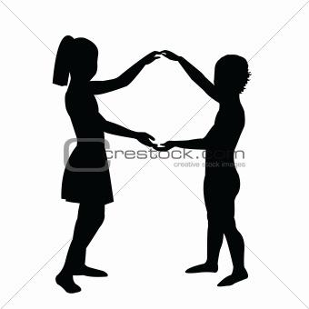 Pair of children holding their hands