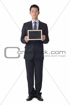 Business man holding blank blackboard