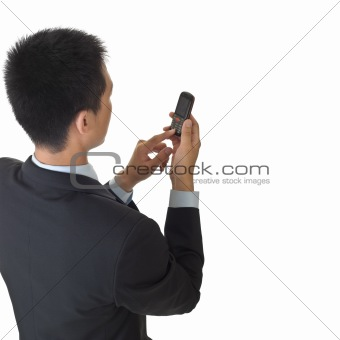Business man holding cellphone