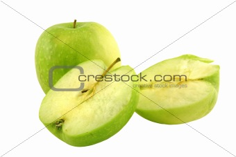 Green apple next to some apple slices