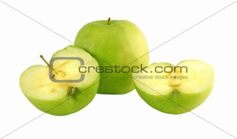 Green apple next to apples slices
