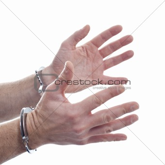Hands and handcuffs