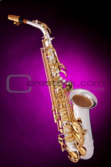 Alto Saxophone Isolated On Pink