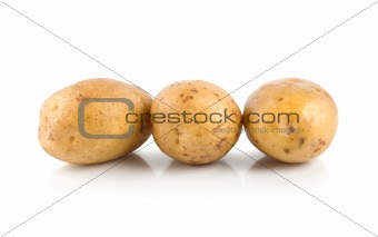 Three raw potatoes isolated on a white