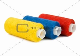 Three spools of threads