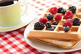 tasty waffle with fruits