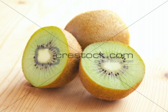 kiwi fruit on wooden table