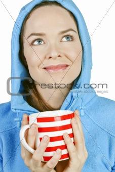 Beautiful fresh woman enjoying a cup of tea or coffe