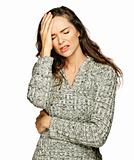 A young attractive woman suffering headache