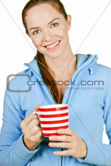 Beautiful young smiling woman holding a cup of coffee or tea